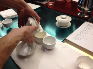 My friend Ian's first try at pouring us tea. By the end of the class the linen was soaked!